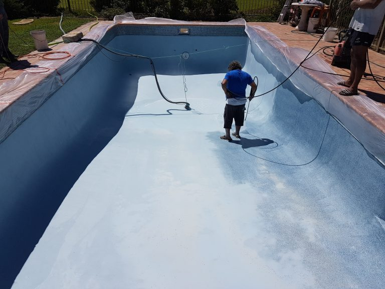 swimming pool was made by custom crete pools & surrounds